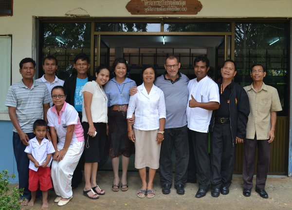 Carsten surrounded by local school teachers and authorities in Surin